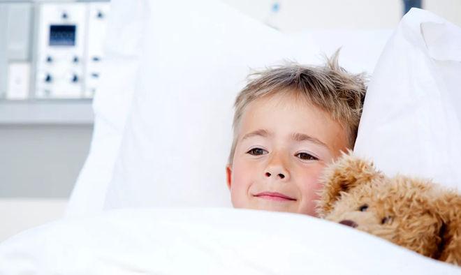 Уложить ребенка в постель